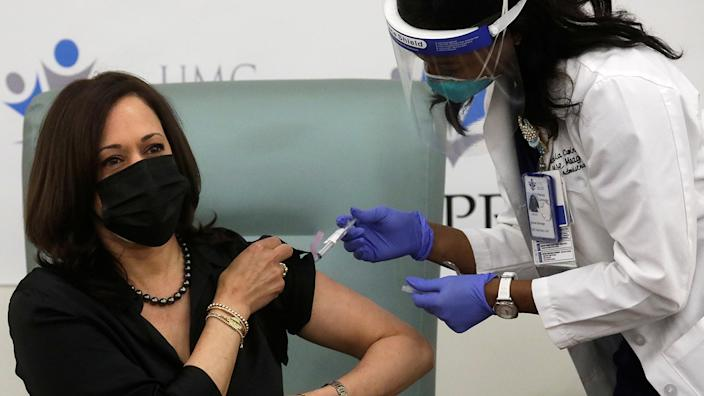 Vice President-elect Kamala Harris receives a dose of the Moderna COVID-19 vaccine at United Medical Center in Washington, D.C., on Tuesday. (Leah Millis/Reuters)