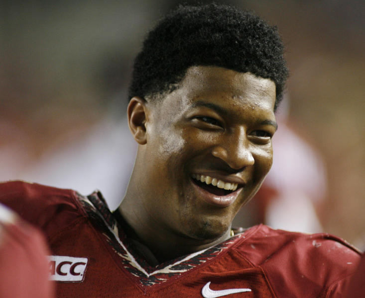 Florida State quarterback Jameis Winston (5) smiles on the sidelines in the fourth quarter of an NCAA college football game against Syracuse on Saturday, Nov. 16, 2013, in Tallahassee, Fla. Florida State best Syracuse 59-3. (AP Photo/Phil Sears)