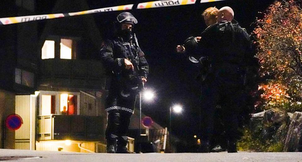 Police officers cordon off the scene where they are investigating in Kongsberg, Norway after a man armed with bow killed several people before he was arrested by police.