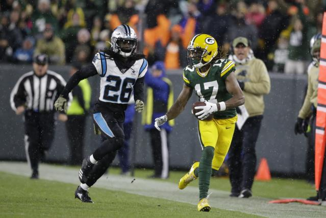Green Bay Packers' Davante Adams catches a pass in front of Carolina Panthers' Donte Jackson during the second half of an NFL football game Sunday, Nov. 10, 2019, in Green Bay, Wis. (AP Photo/Jeffrey Phelps)
