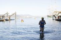 A swimmer with the South End Rowing Club exits the water at the Aquatic Park after finishing the annual New Year's Day swim in San Francisco, California January 1, 2015. REUTERS/Stephen Lam (UNITED STATES - Tags: ANNIVERSARY SOCIETY)