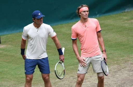 Brothers Mischa (L) and Alexander Zverev of Germany, seen during a doubles match at a tournament in Halle, in June 2018