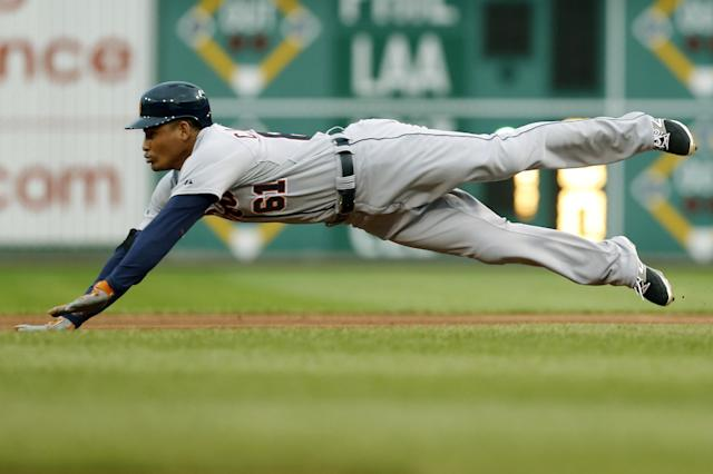 Detroit Tigers' Ezequiel Carrera (61) dives for second base with a double in the first inning of the baseball game against the Pittsburgh Pirates on Tuesday, Aug. 12, 2014, in Pittsburgh. Carrera then scored on a hit by Ian Kinsler that inning. (AP Photo/Keith Srakocic)