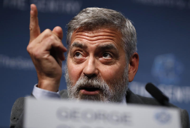 """US actor and activist George Clooney speaks at a press conference about South Sudan in London, Thursday, Sept. 19, 2019. The largest multinational oil consortium in South Sudan is """"proactively participating in the destruction"""" of the country, the actor George Clooney and co-founder of The Sentry watchdog group told The Associated Press this week. (AP Photo/Alastair Grant)"""