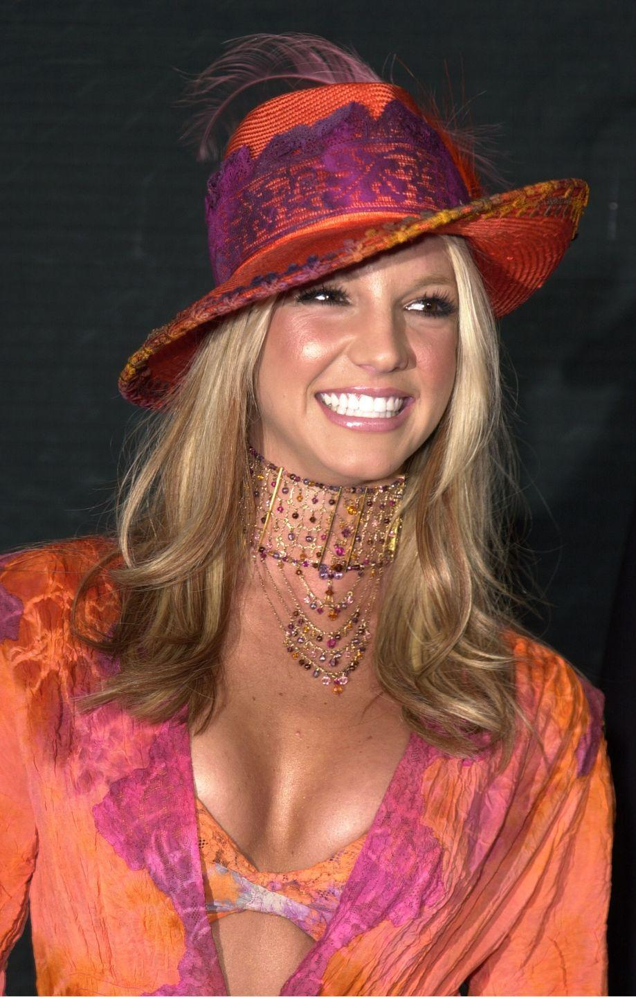 <p>See?? Britney LOVES a hat. Even...this Victorian-esque (??) one that she wore to the Billboard Music Awards. (Yes, good eye, it also matches her...lingerie set.) </p>