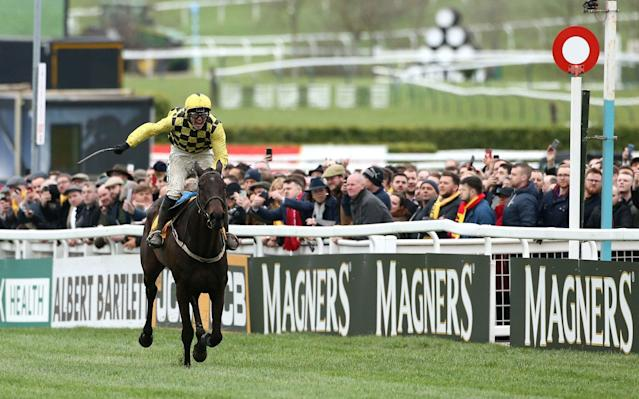 Jockey Paul Townend celebrates his victory in the Magners Cheltenham Gold Cup Chase on Al Boum Photo during Gold Cup Day of the 2019 Cheltenham Festival at Cheltenham Racecourse - PA