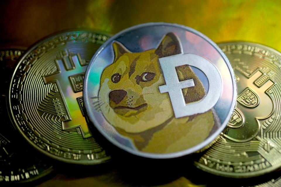 KATWIJK, NETHERLANDS - JANUARY 29: In this photo illustration, visual representations of digital cryptocurrencies, Dogecoin and Bitcoin are arranged on January 29, 2021 in Katwijk, Netherlands.  (Photo by Yuriko Nakao/Getty Images)