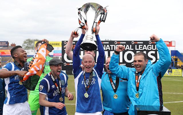Soccer Football - National League - Macclesfield Town v Dagenham & Redbridge - Moss Rose, Macclesfield, Britain - April 28, 2018 Macclesfield Town's Danny Whitaker celebrates winning the national league as he lifts the trophy with team mates Action Images/Peter Cziborra