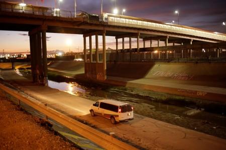 A vehicle of the National Migration Institute (INM) patrols along the Rio Bravo river as part of an ongoing operation to prevent migrants from crossing illegally into the United States, in Ciudad Juarez