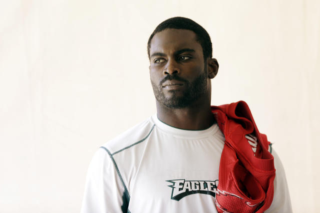 Philadelphia Eagles quarterback Michael Vick waits his turn to participate in a news conference after practice at the NFL football team's training facility, Tuesday, Oct. 15, 2013, in Philadelphia. (AP Photo/Matt Rourke)