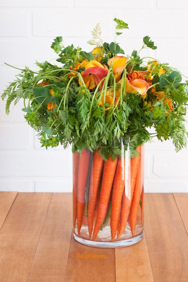 "<p>Use your farmers' market finds to craft this <a rel=""nofollow"" href=""https://www.womansday.com/home/crafts-projects/g2886/diy-easter-wreaths/"">pretty arrangement</a> that the Easter bunny is sure to love. </p><p><strong>Get the tutorial at <a rel=""nofollow"" href=""https://thechicsite.com/2015/03/24/carrot-centerpiece/"">The Chic Site</a>.</strong></p>"