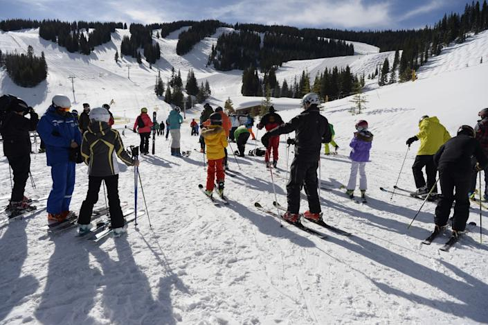 "Skiers prepare for their day at the base of Vail in the Mountain Plaza area. Resorts in Colorado are now closed due to the coronavirus. <span class=""copyright"">(Andy Cross / Denver Post)</span>"