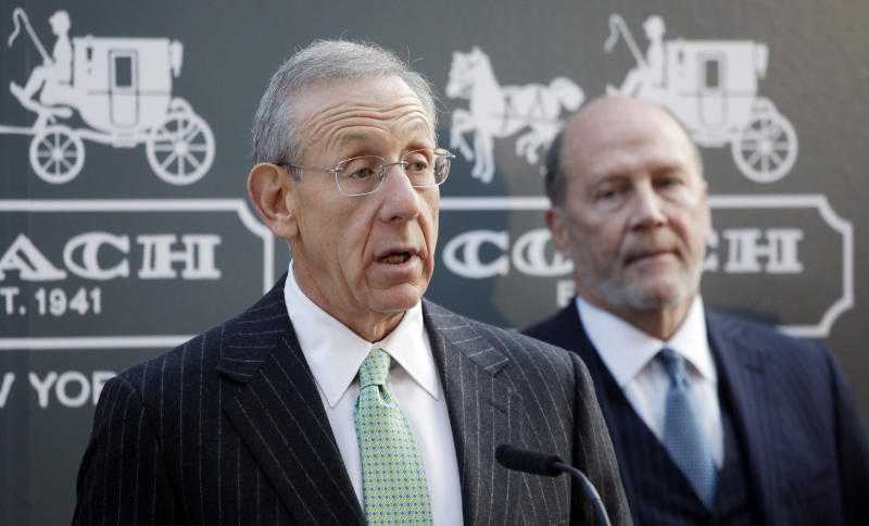 FILE - In this Nov. 1, 2011 file photo, Stephen Ross, left, chairman and CEO of The Related Industries, and Lew Frankfort, chairman and CEO of Coach, Inc., discuss the Hudson Yards development, in New York. Related will co-develop the site planned to cover the Long Island Rail storage yards on Manhattan's west side. Coach will occupy one of two office towers planned for the site. (AP Photo/Mark Lennihan, File)