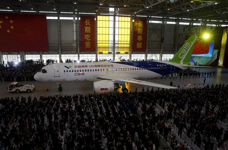 FILE PHOTO: The first C919 passenger jet made by the Commercial Aircraft Corp of China (Comac) is pulled out during a news conference at the company's factory in Shanghai