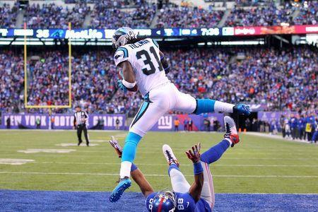 Dec 20, 2015; East Rutherford, NJ, USA; Carolina Panthers defensive back Charles Tillman (31) intercepts a pass intended for New York Giants wide receiver Hakeem Nicks (88) after Nicks falls down during the fourth quarter at MetLife Stadium. Mandatory Credit: Brad Penner-USA TODAY Sports