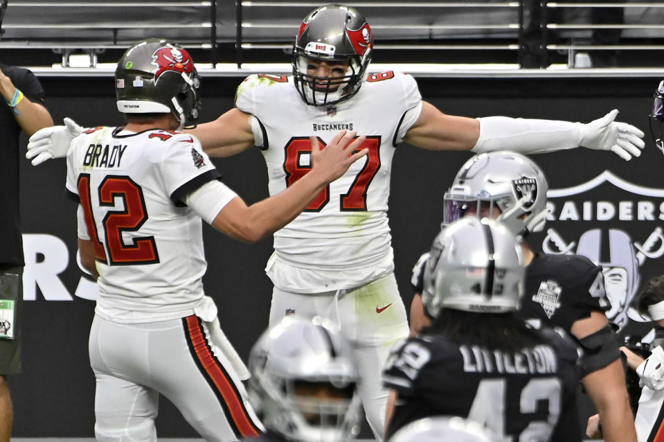 Tampa Bay Buccaneers tight end Rob Gronkowski celebrates with quarterback Tom Brady, left, after Gronkowski scored a touchdown against the Las Vegas Raiders during the first half of an NFL football game, Sunday, Oct. 25, 2020, in Las Vegas. (AP Photo/David Becker)