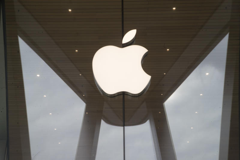 FILE- In this Jan. 3, 2019, file photo the Apple logo is displayed at the Apple store in the Brooklyn borough of New York. A jury announced the verdict Friday, March 15, that Apple should pay $31 million in damages for infringing on patents for technology owned by mobile chip maker Qualcomm that helps iPhones quickly connect to the internet and extend their battery life. (AP Photo/Mary Altaffer, File)