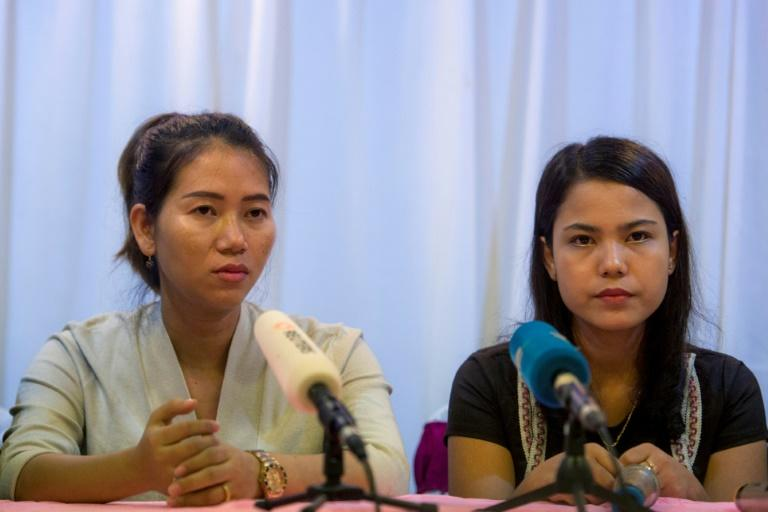 Pan Ei Mon (L) and Chit Su Win (R), wives of detained Reuters journalists Wa Lone and Kyaw Soe Oo, attend a press conference