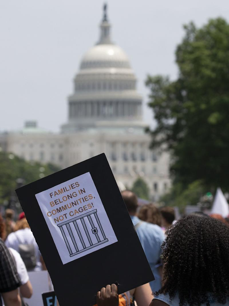 Demonstrators march against the separation of immigrant families before the US Capitol Building, June 30, 2018 in Washington, DC. - Thousands of demonstrators, baking in the heat and opposed to US immigration policy, marched across the country Saturday, June 30, 2018 to protest the separation of families under President Donald Trump. (Photo by Alex Edelman / AFP) (Photo credit should read ALEX EDELMAN/AFP/Getty Images)