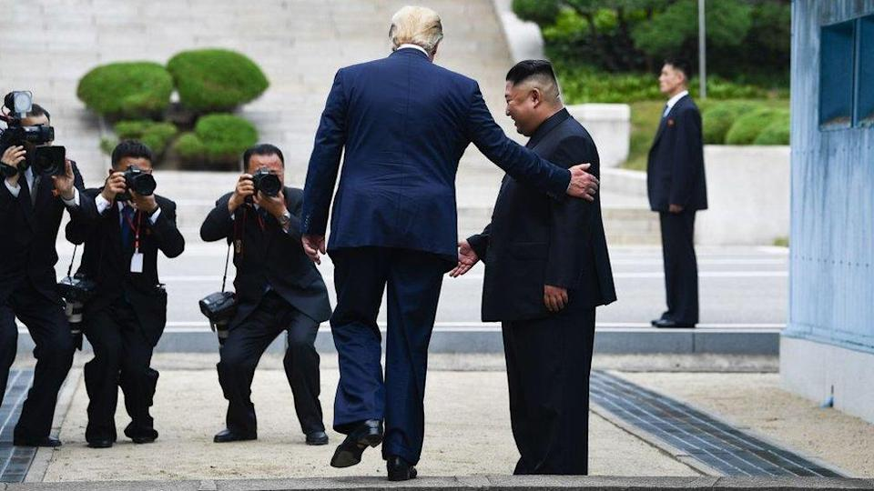 Mr Trump steps into the northern side of the military demarcation line dividing the two Koreas