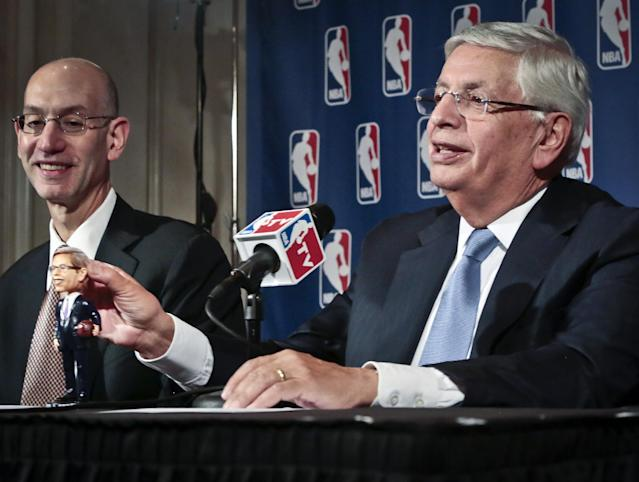 NBA Deputy Commissioner Adam Silver, left, smiles as NBA Commissioner David Stern shows a bobblehead doll in his likeness, during a press conference after a meeting of the NBA board of governors, Wednesday, Oct. 23, 2013 in New York. Stern will formally step aside Feb. 1, 2014, after 30 years and Silver will become the new NBA commissioner. (AP Photo/Bebeto Matthews)