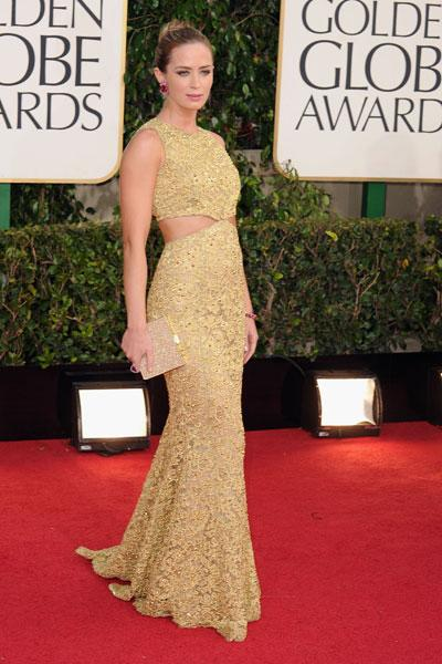 Emily Blunt: Wow! Emily Blunt is stunning in a gold-yellow gown with side cutouts that's less Kardashian and more Oscar-winner. (Photo by Steve Granitz/WireImage)