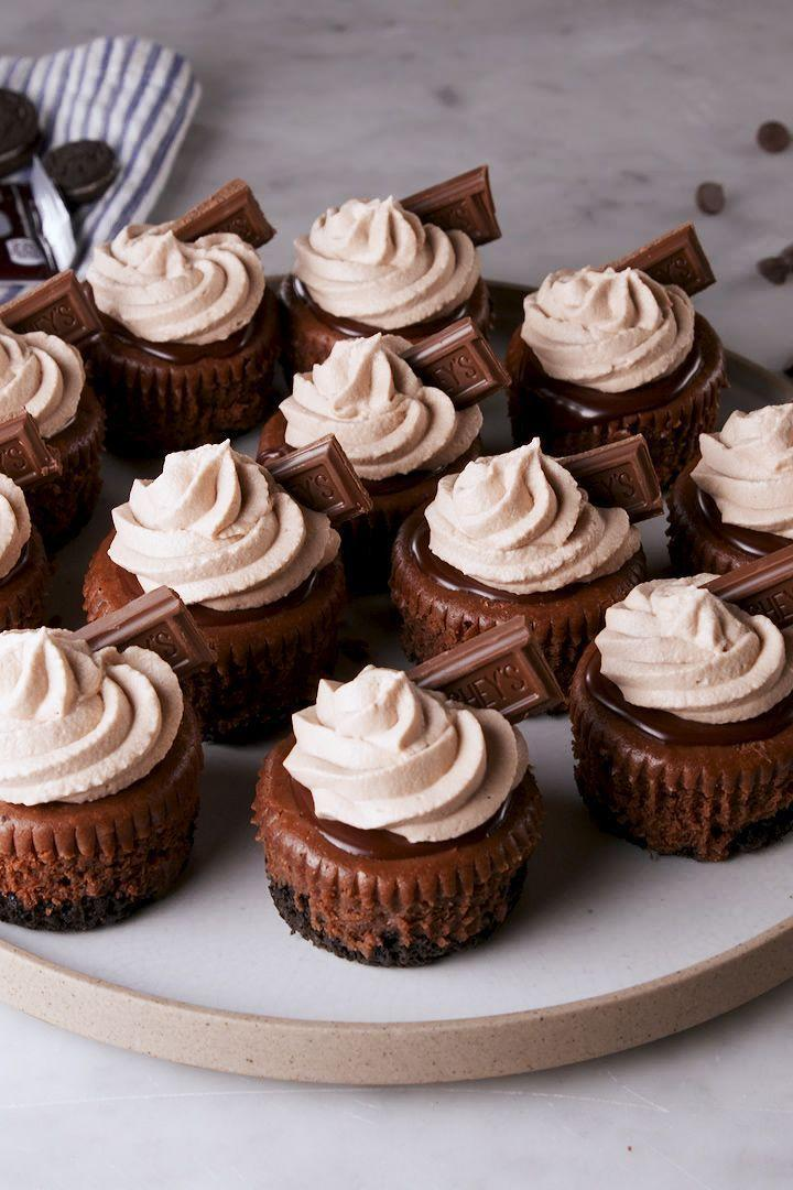 """<p>Mini cheesecakes are the best way to get a party started...or rather, the best way to end one. Either way, death by chocolate is always the best of the best. These cupcakes are rich and creamy, and chocolate is involved from top to bottom. They're the perfect indulgence. </p><p>Get the <a href=""""https://www.delish.com/uk/cooking/recipes/a28925883/mini-death-by-chocolate-cheesecakes-recipe/"""" rel=""""nofollow noopener"""" target=""""_blank"""" data-ylk=""""slk:Mini Death by Chocolate Cheesecakes"""" class=""""link rapid-noclick-resp"""">Mini Death by Chocolate Cheesecakes</a> recipe. </p>"""