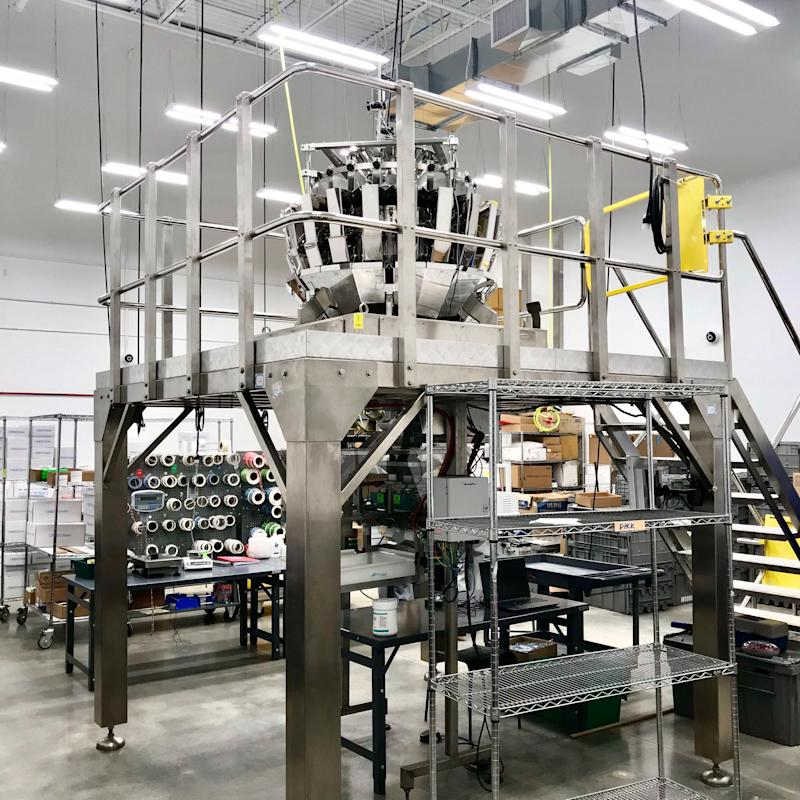 "A ""bud sorting"" machine at Cresco Labs in Joliet, Illinois on May 22, 2019. The sorter is designed to weigh and package dried marijuana flower. Photo credit: Alexis Keenan/Yahoo Finance"
