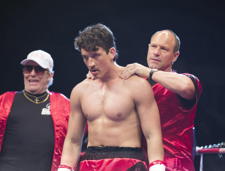 """In this image released by Open Road Films, Ciaran Hinds, from left, Miles Teller and Aaron Eckhart appear in a scene from the film, """"Bleed For This."""" (Seacia Pavao/Open Road Films via AP)"""