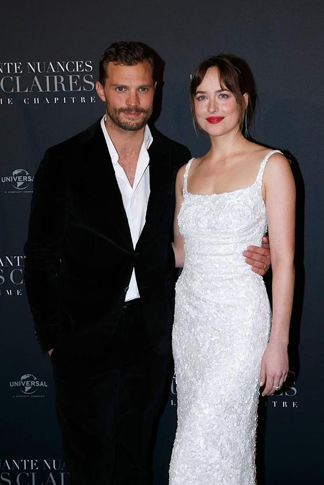<p>Get your blindfolds ready! The co-stars posed on the red carpet Tuesday night at the Paris premiere of <em>Fifty Shades Freed — </em>the third and final installment of the sexy series. (Photo: Bertrand Rindoff Petroff/Getty Images) </p>