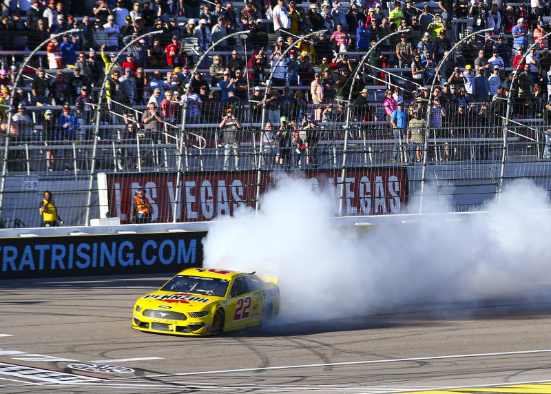 Joey Logano (22) does a burnout after winning a NASCAR Cup Series auto race at Las Vegas Motor Speedway on Sunday, Feb. 23, 2020. (AP Photo/Chase Stevens)
