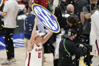 Alabama's Britton Johnson celebrates after beating LSU in the championship game of the NCAA college basketball Southeastern Conference Tournament Sunday, March 14, 2021, in Nashville, Tenn. Alabama won 80-79. (AP Photo/Mark Humphrey)