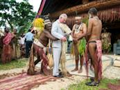 The Prince of Wales is given a grass skirt to wear in Vanuatu