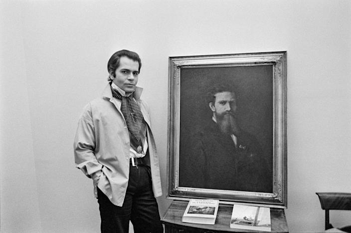 <p>Fashion designer Karl Lagerfeld relaxes at his home in Paris in 1976.</p>