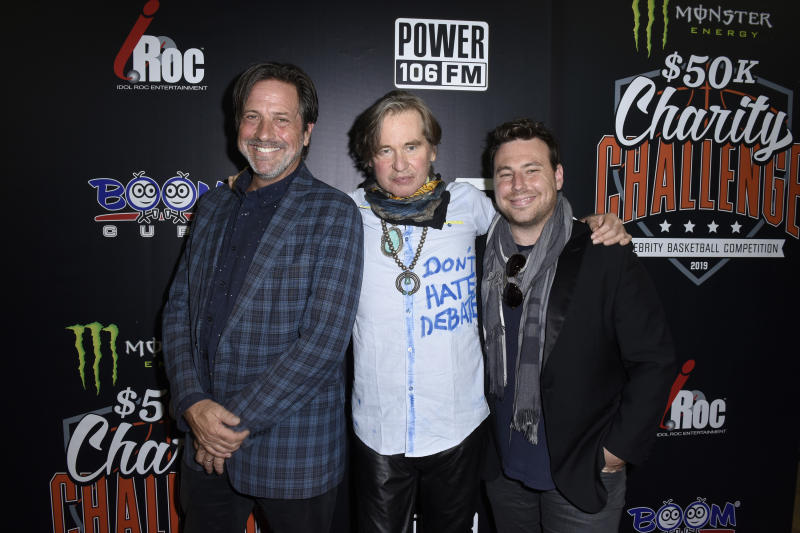 WESTWOOD, CALIFORNIA - JULY 08: Val Kilmer (C) and guests attend the Monster Energy $50K Charity Challenge Celebrity Basketball Game at UCLA's Pauley Pavilion on July 08, 2019 in Westwood, California. (Photo by Vivien Killilea/Getty Images for Idol Roc )