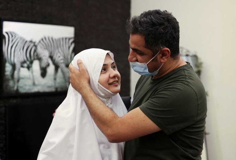 Pakistani pilgrim Bushra Shah bids her husband farewell before leaving for the hajj -- the first time she can do so without a male guardian
