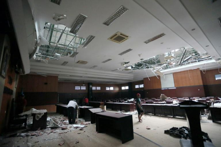 Workers clear debris from the hall of a local parliament building in Blitar, after a 6.0 magnitude earthquake struck off the coast of Java island