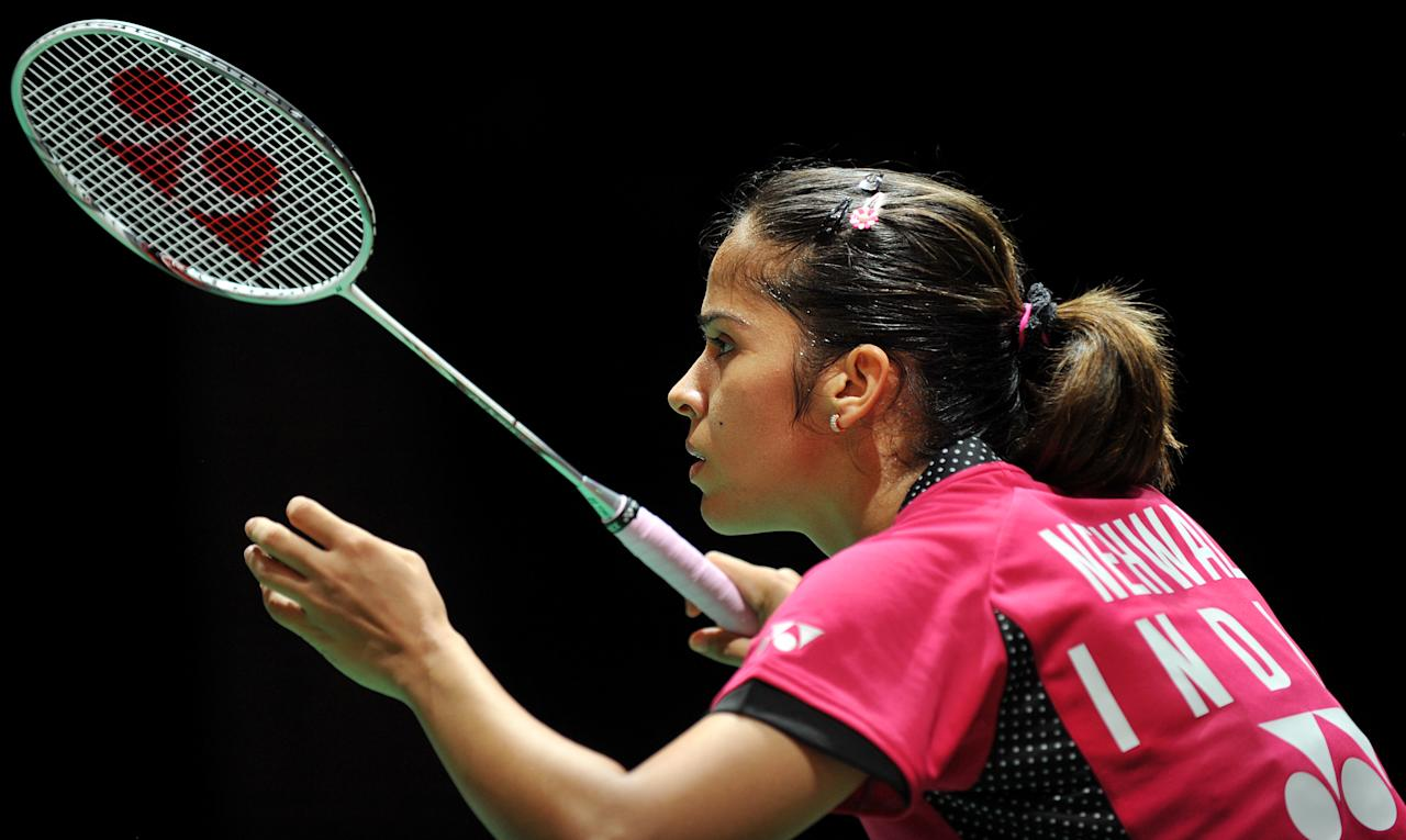 India's Saina Nehwal prepares to return a shot to China's Wang Xin (not seen) during the womens singles quater finals at the World Badminton Championships at Wembley Arena in London, on August 12, 2011. AFP PHOTO/BEN STANSALL (Photo credit should read BEN STANSALL/AFP/Getty Images)