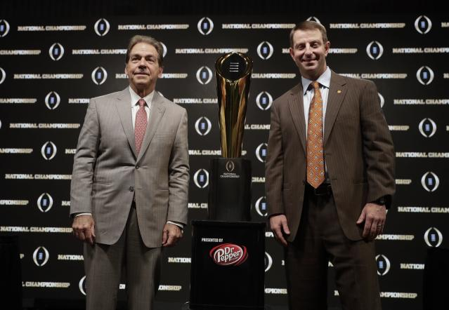 Alabama coach Nick Saban and Clemson coach Dabo Swinney have split four games in the College Football Playoff, but Swinney has the 2-1 edge in title games. (AP Photo/David J. Phillip)