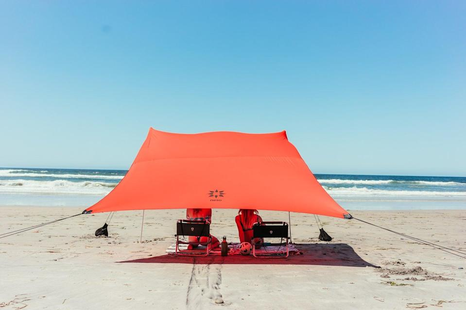 """<h2>Neso 1 Sunshade</h2>Make it easy for friends to spot you with this punchy tent. The amount of headroom can be adjusted with the tension stretch cover, and the corner anchors are filled sand, rocks, and smooth shells — consider collecting them another beach activity! <br><br><em><strong>Shop <a href=""""https://www.rei.com/b/neso"""" rel=""""nofollow noopener"""" target=""""_blank"""" data-ylk=""""slk:Neso"""" class=""""link rapid-noclick-resp"""">Neso</a></strong></em><br><br><strong>Neso</strong> Neso 1 Sunshade, $, available at <a href=""""https://go.skimresources.com/?id=30283X879131&url=https%3A%2F%2Fwww.rei.com%2Fproduct%2F123573%2Fneso-1-sunshade"""" rel=""""nofollow noopener"""" target=""""_blank"""" data-ylk=""""slk:REI"""" class=""""link rapid-noclick-resp"""">REI</a>"""