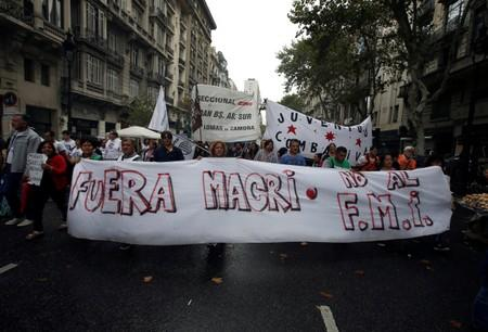 FILE PHOTO: Argentine unions, small firms and activists march near Argentina's Congress to demand changes in President Mauricio Macri's economic policies, in Buenos Aires