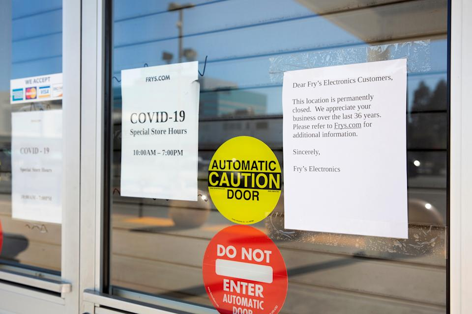 Signs stating the store's permanent closure are posted on the front door at a Fry's Electronics store, after the chain announced that they would cease operations and close all branches due to changing retail conditions and challenges posed by the coronavirus pandemic, in Concord, California, U.S. February 24, 2021.  REUTERS/Brittany Hosea-Small