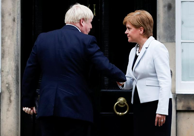 Britain's Prime Minister Boris Johnson shakes hands with Scotland's First Minister Nicola Sturgeon at Bute House in Edinburgh, Scotland, Britain July 29, 2019. REUTERS/Russell Cheyne