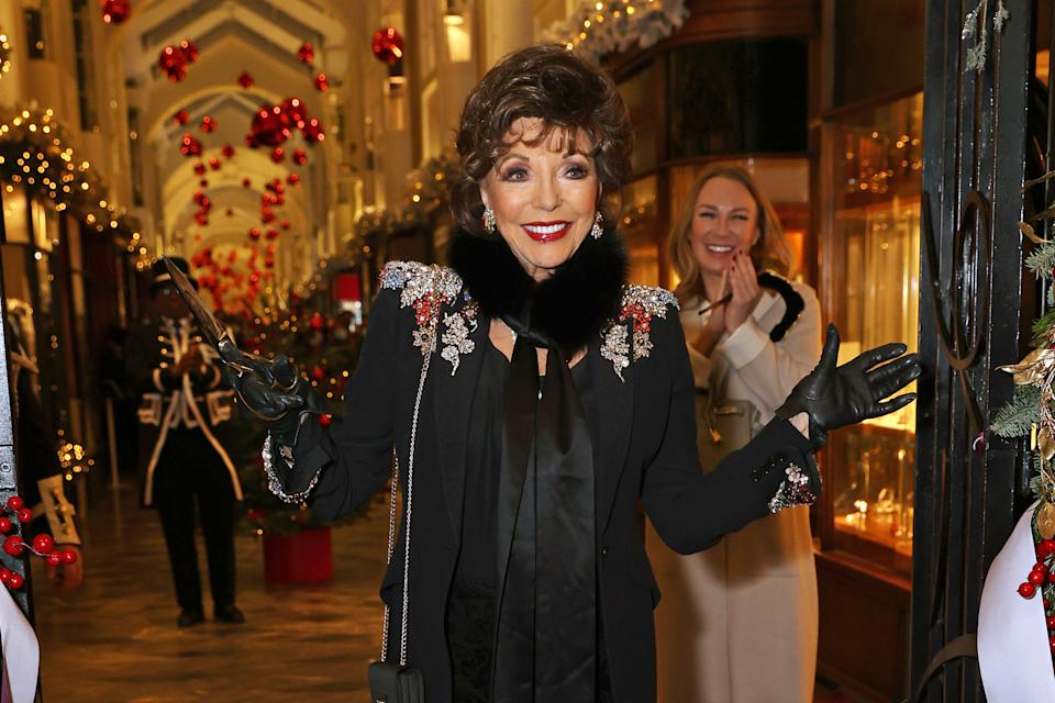 LONDON, ENGLAND - DECEMBER 05: Dame Joan Collins attends the Burlington Arcade Christmas Lights switch on at Burlington Arcade on December 5, 2020 in London, England. (Photo by David M. Benett/Dave Benett/Getty Images)