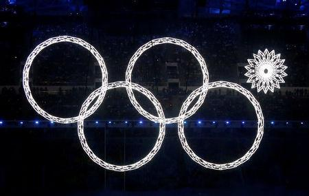 Four of five Olympic Rings are seen lit up during the opening ceremony of the 2014 Sochi Winter Olympics, February 7, 2014. REUTERS/Lucy Nicholson/File Photo