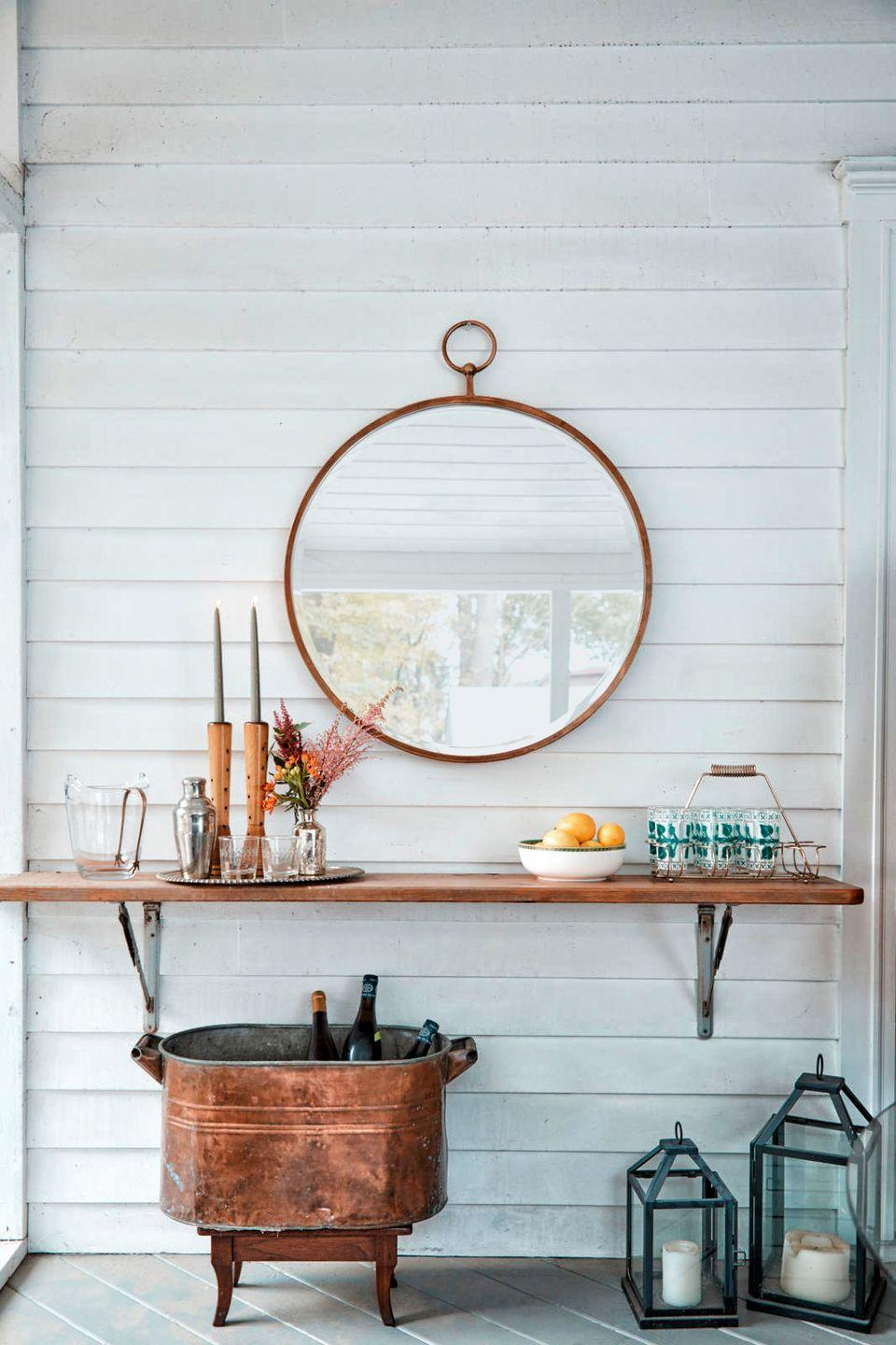 <p>Up for a DIY? Install a wooden shelf right on your porch, and you'll have an instant serving station. <br></p>