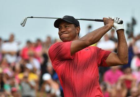 Woods rallies for par in Memorial return