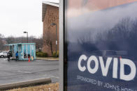 In this Thursday, Feb. 11, 2021, photo people arrive for COVID-19 vaccinations at a clinic outside the Pennsylvania Avenue Baptist Church, Thursday, Feb. 11, 2021, in southeast Washington. (AP Photo/Jacquelyn Martin)