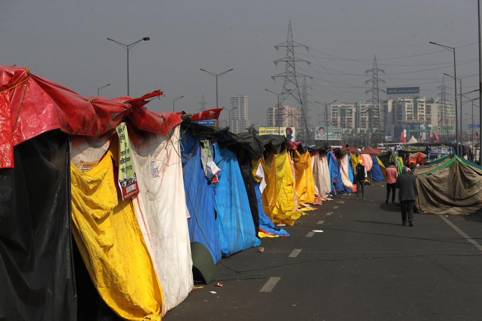 Farmers put up makeshift tents as more of them return to protest against new farm laws, at the Delhi-Uttar Pradesh border, on the outskirts of New Delhi, India, Saturday, Jan. 30, 2021. Indian farmers and their leaders spearheading more than two months of protests against new agriculture laws began a daylong hunger strike Saturday, directing their fury toward Prime Minister Narendra Modi and his government. Farmer leaders said the hunger strike, which coincides with the death anniversary of Indian independence leader Mahatma Gandhi, would reaffirm the peaceful nature of the protests. (AP Photo/Manish Swarup)