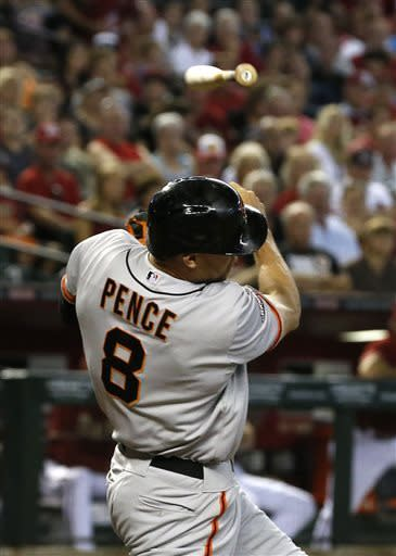 San Francisco Giants' Hunter Pence loses his bat as he takes a swing during the first inning in a baseball game against the Arizona Diamondbacks on Sunday, June 9, 2013, in Phoenix. (AP Photo/Ross D. Franklin)